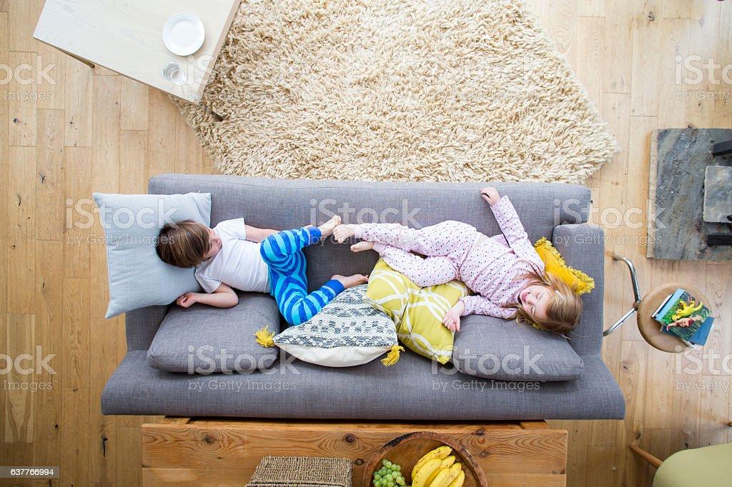 Siblings on the Sofa stock photo