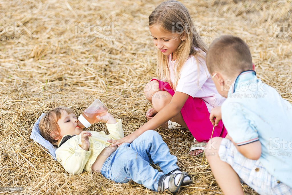 Siblings outdoors. royalty-free stock photo