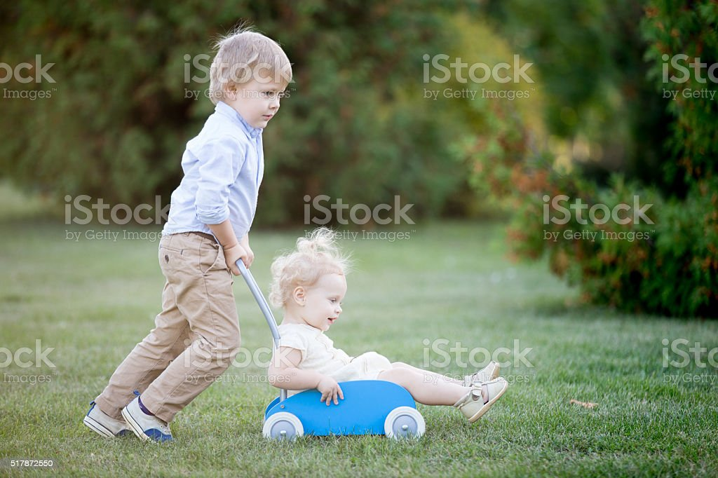 Siblings playing together stock photo