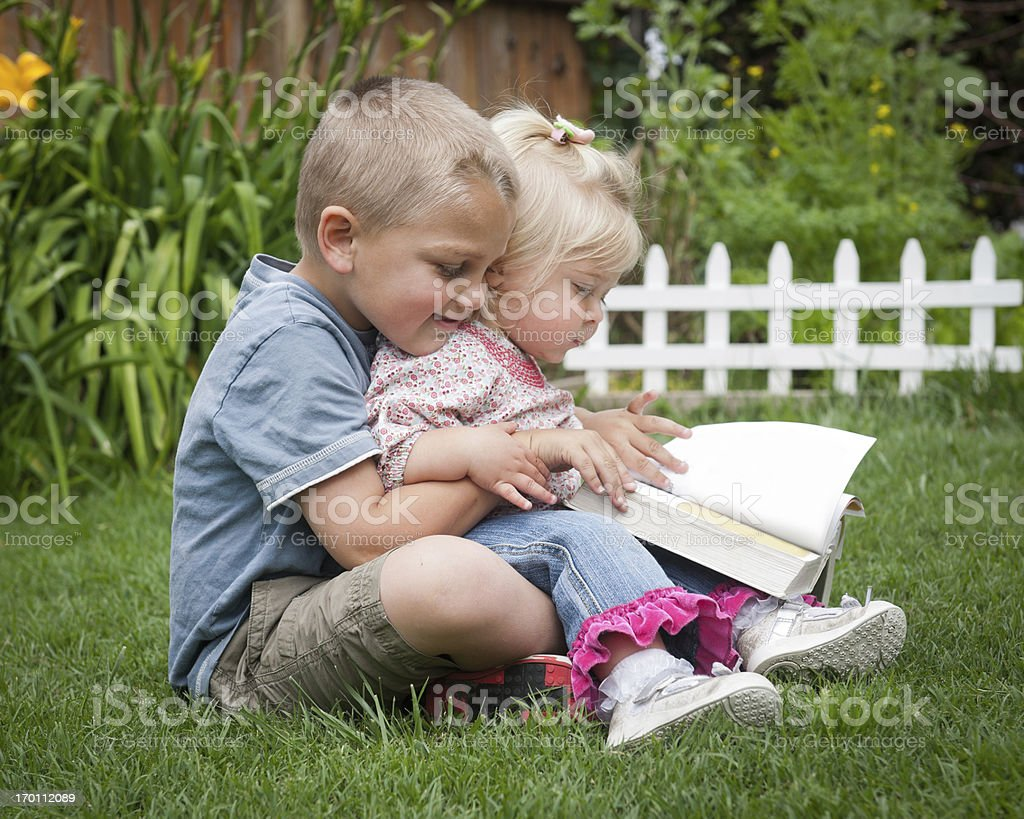 Siblings Reading stock photo
