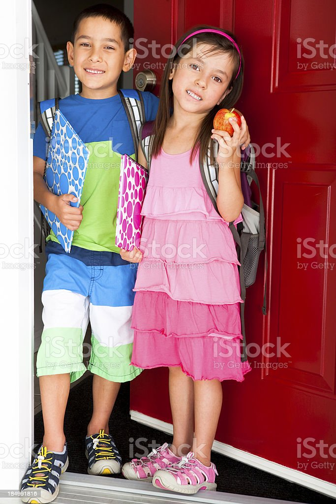 Siblings ready for school royalty-free stock photo