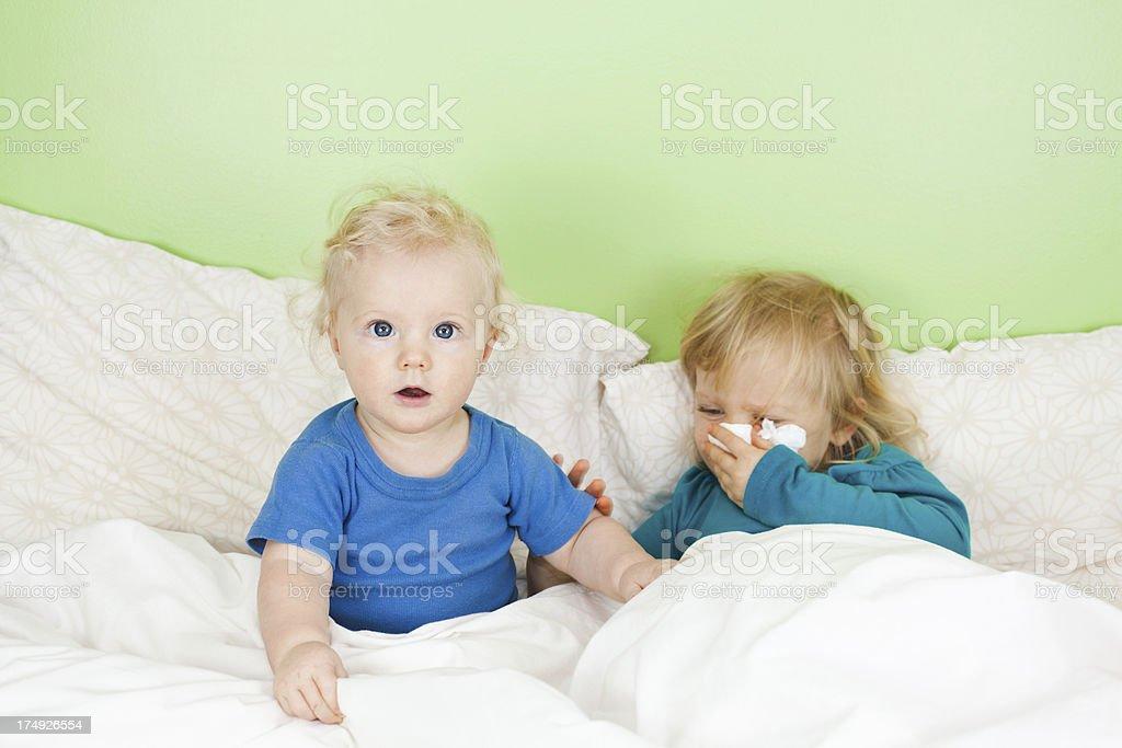 Siblings sick in bed royalty-free stock photo
