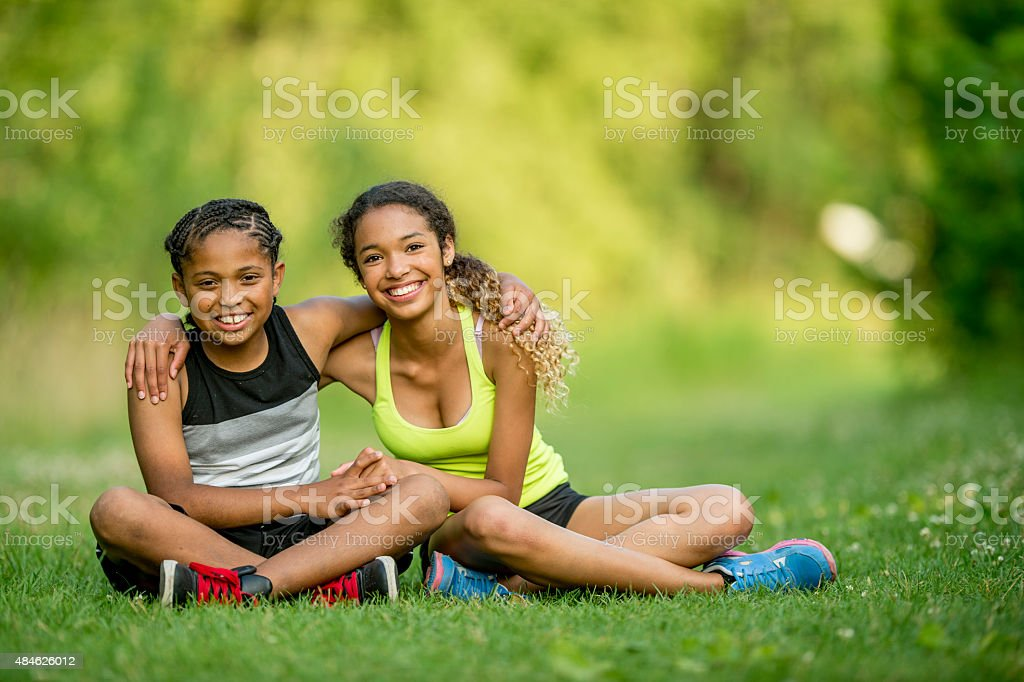 Siblings Sitting at the Park stock photo