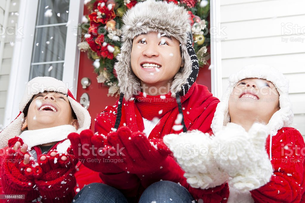 Siblings sitting playing with the snow royalty-free stock photo