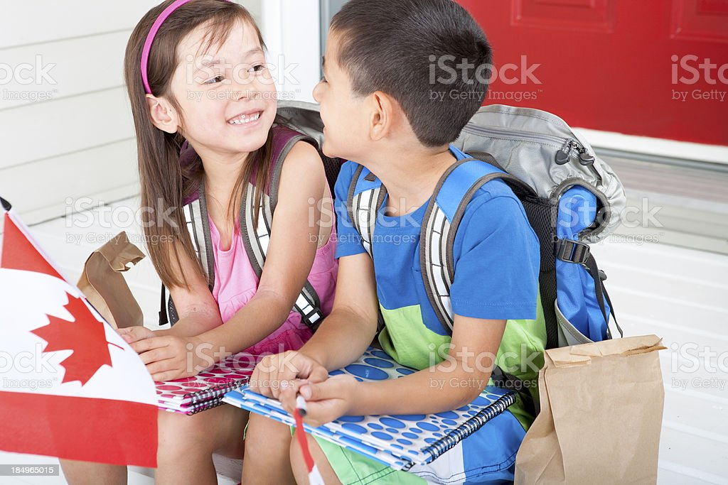 Siblings student holding canadian flag royalty-free stock photo