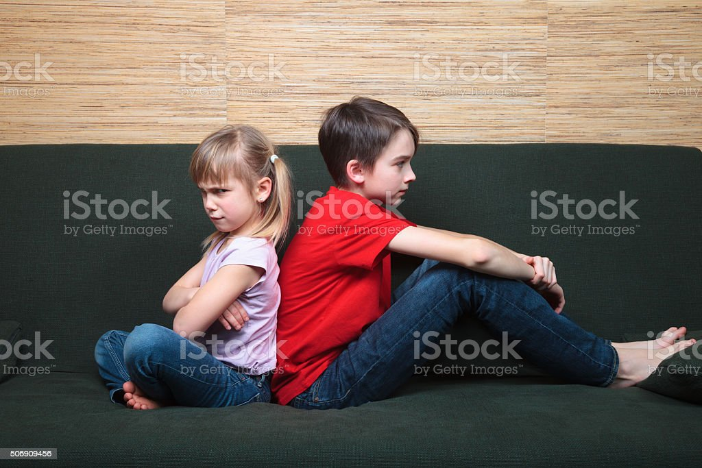 Siblings sulking after fight stock photo