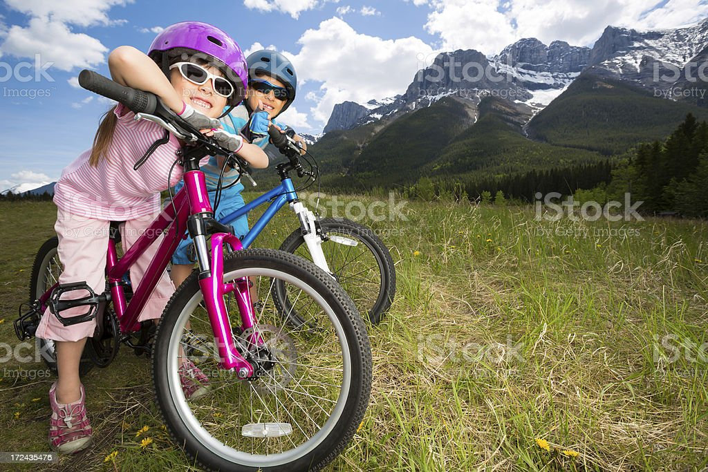 Siblings taking a break from biking to enjoy the view royalty-free stock photo