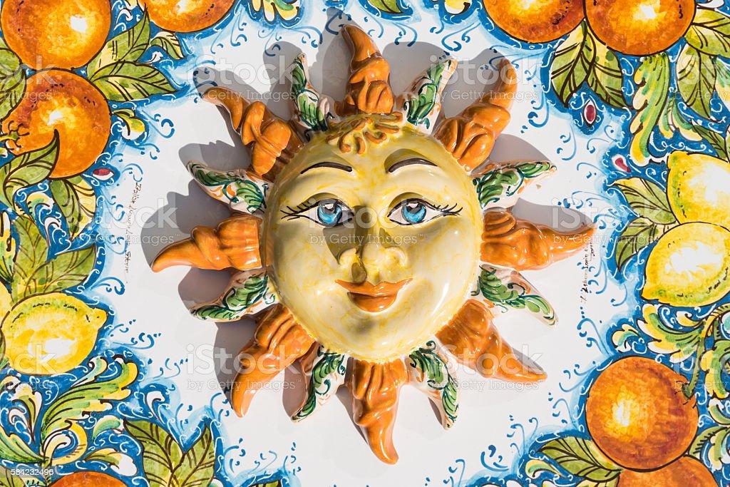 Sicilian sun face of ceramic in Taormina, Italy stock photo