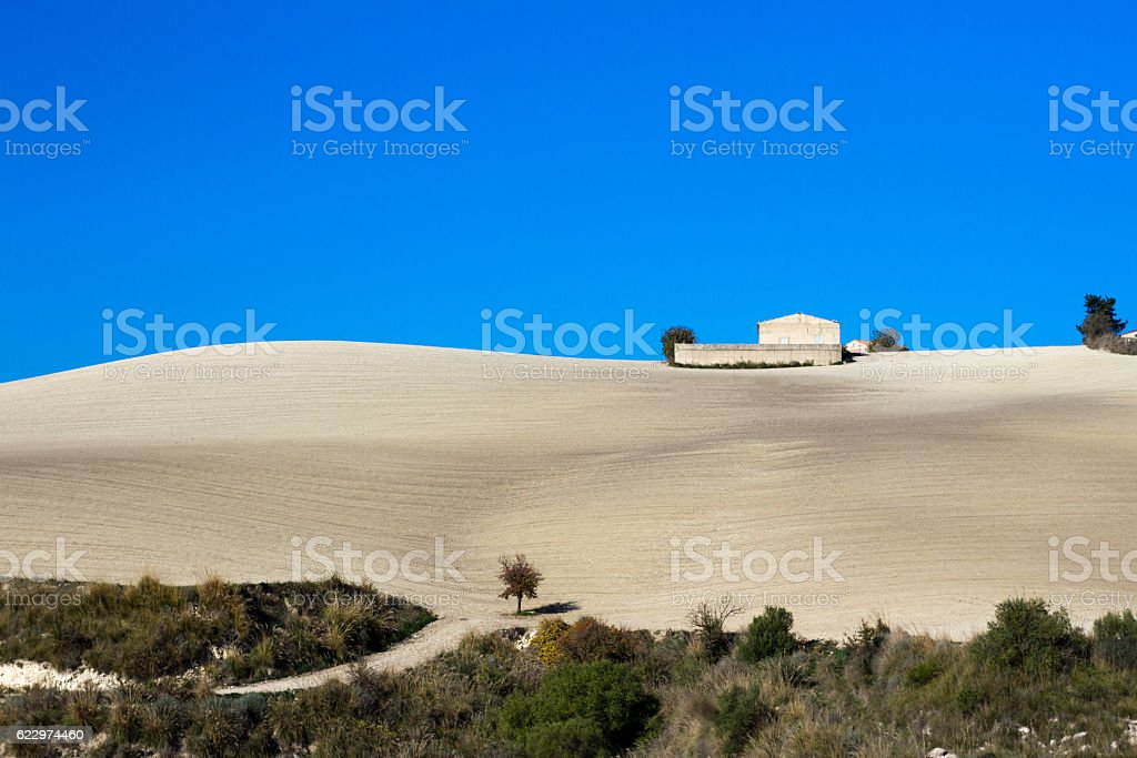 Sicily: Beautiful Rolling Autumnal Landscape in Blue and Beige stock photo