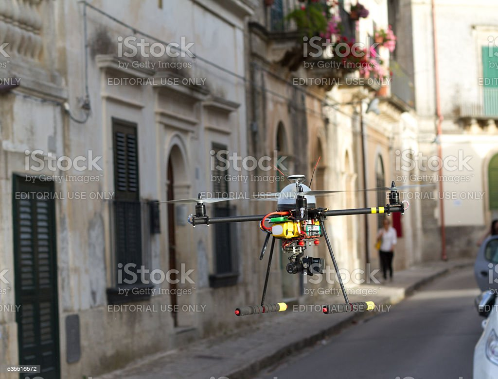 Sicily: Drone with Camera Flies Down Village Street (Close-Up) stock photo
