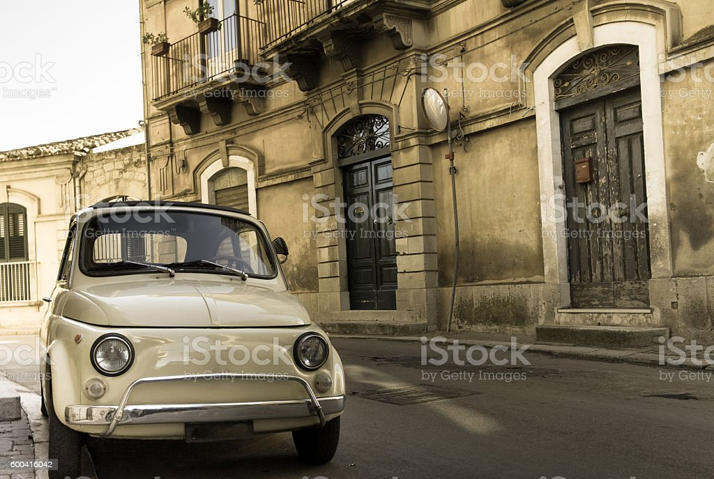 Sicily, Italy: Cute Yellow Vintage Car, Old Street, Front View stock photo