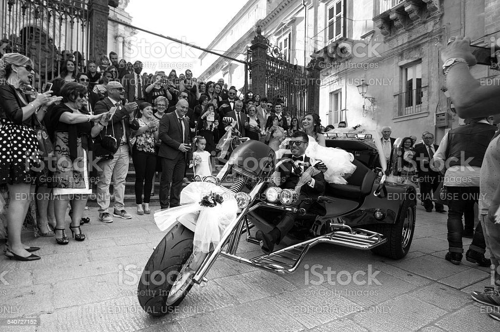 Sicily: Newlyweds Pull Away From Church on Motorbike stock photo