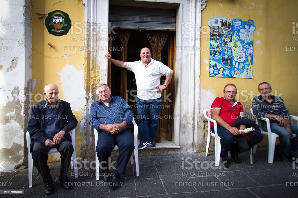 Sicily Scene: Group (Barista and Customers) Outside Bar stock photo