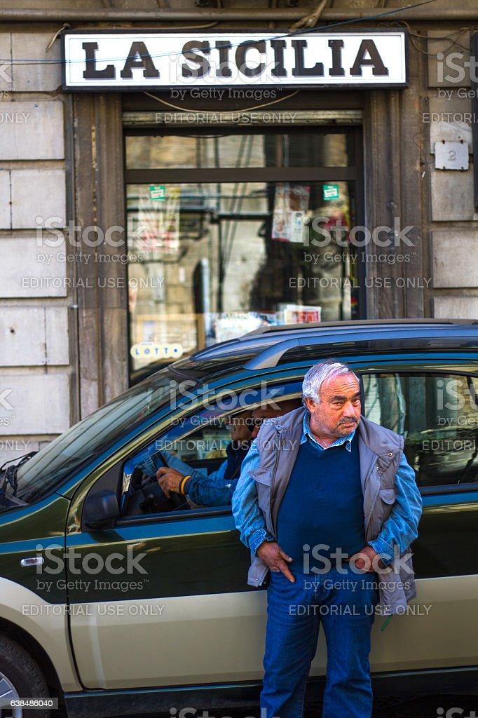 Sicily: Sicilian Senior Stands Near 'LA SICILIA' Sign stock photo