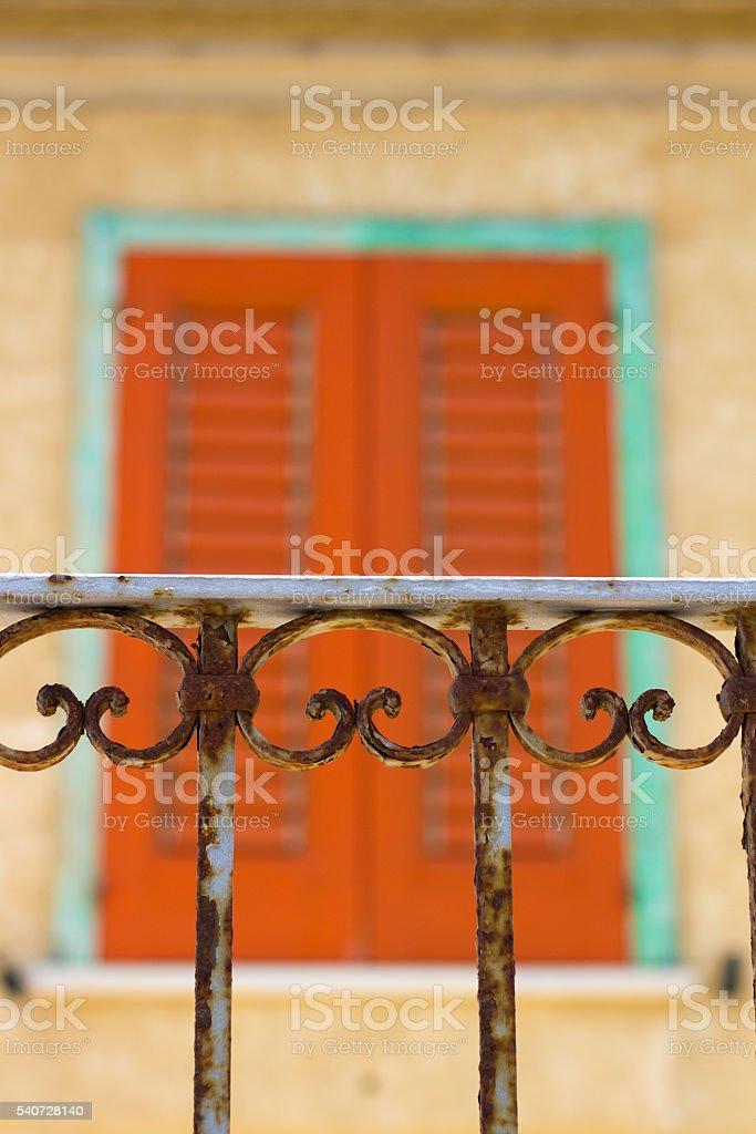 Sicily Style: Balcony Railing and Orange Shutters stock photo