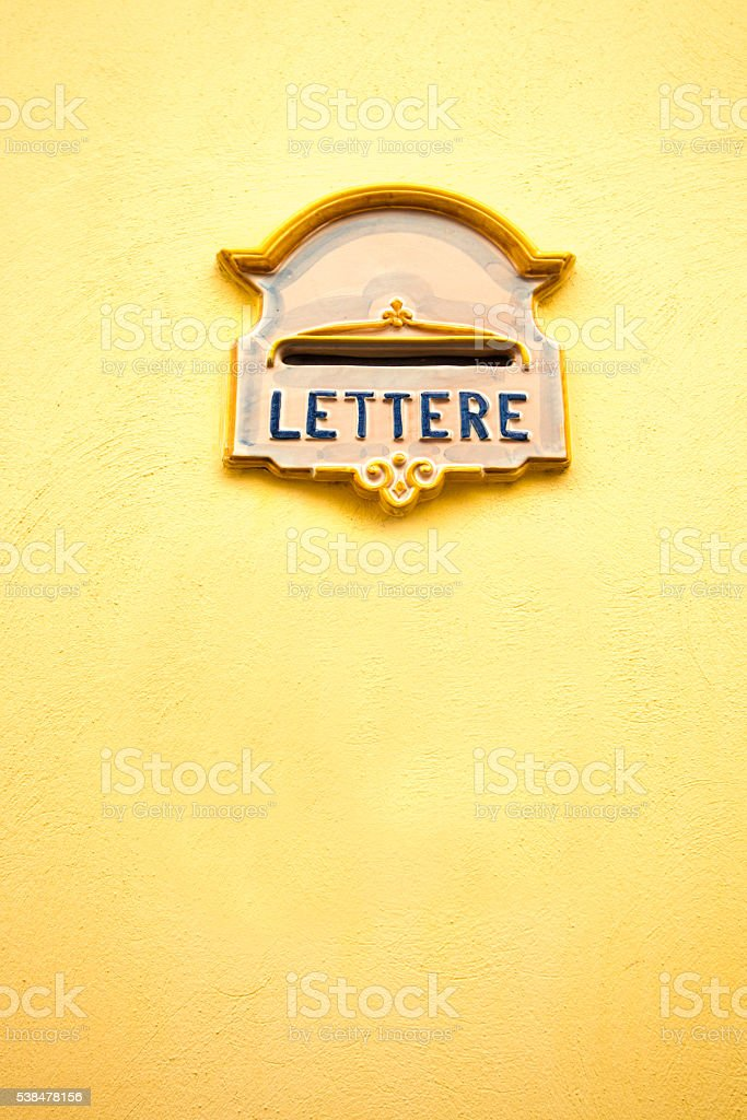 Sicily Style: Ceramic Mailbox in Bright Yellow Wall, Italy stock photo