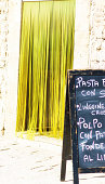 Sicily Style: Sunlit Yellow Beaded Curtain, Blackboard Menu