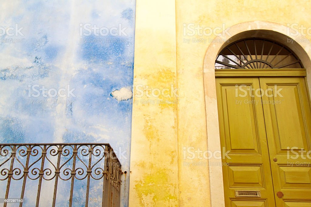 Sicily: Typical Arched Door, Yellow Wall, Blue Wall, Vibrant Colors stock photo