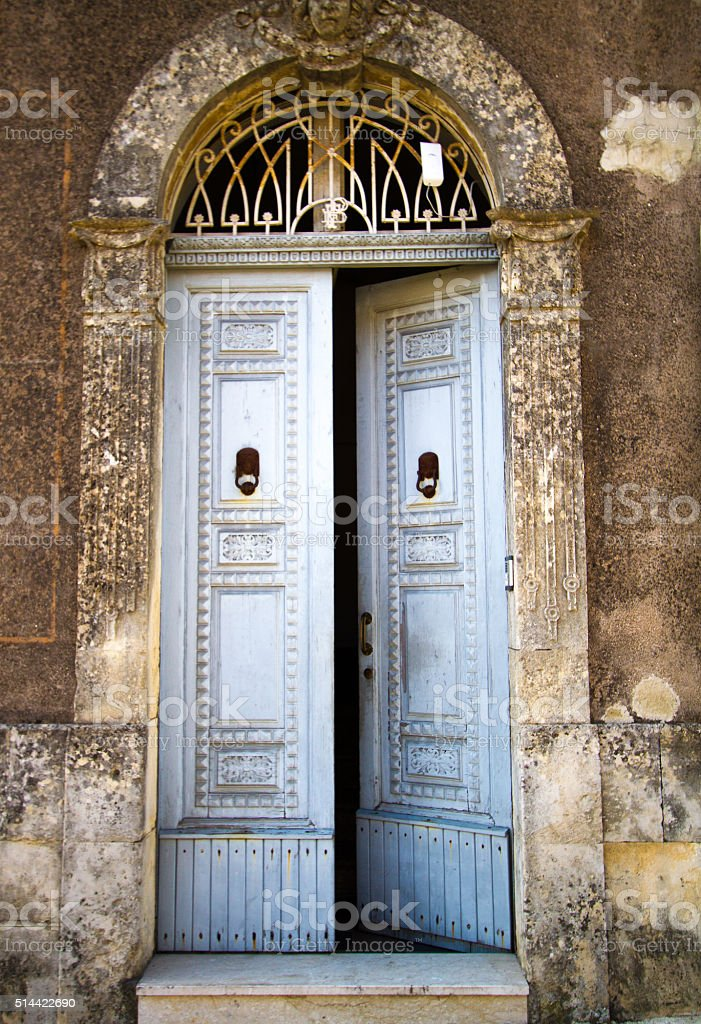 Sicily: Typical Old Arched Wooden Door Entrance, Ajar stock photo