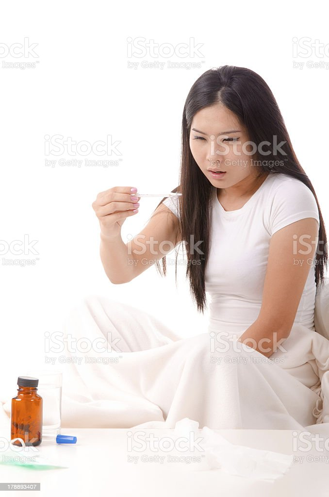 sick asian girl with high fever ,isolated on white royalty-free stock photo