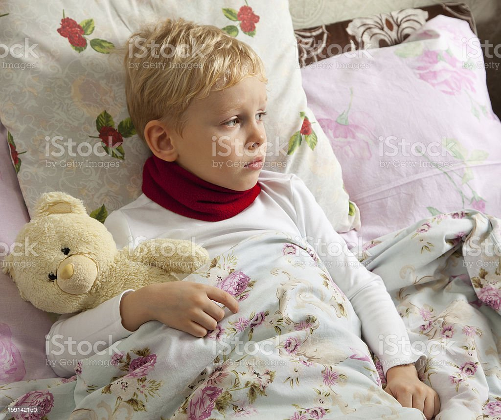 Sick boy is in bed royalty-free stock photo