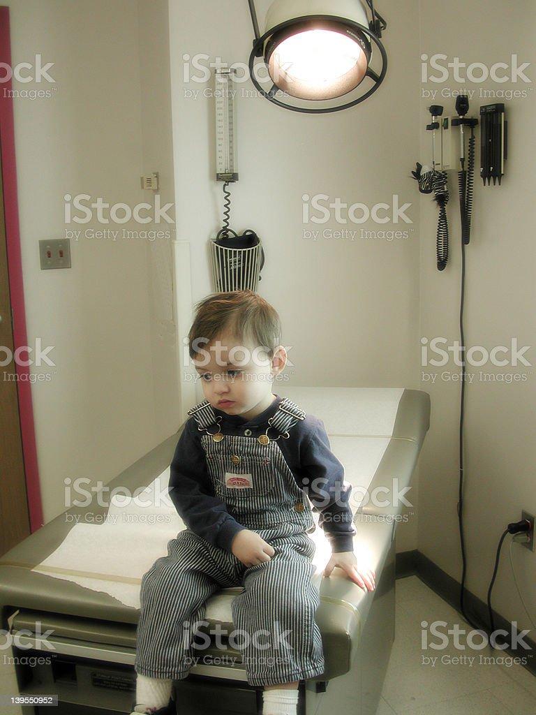 Sick Boy on Table royalty-free stock photo