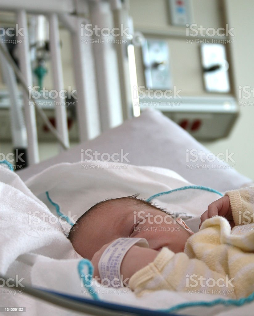 Sick Caucasian Baby in a Children's Hospital stock photo