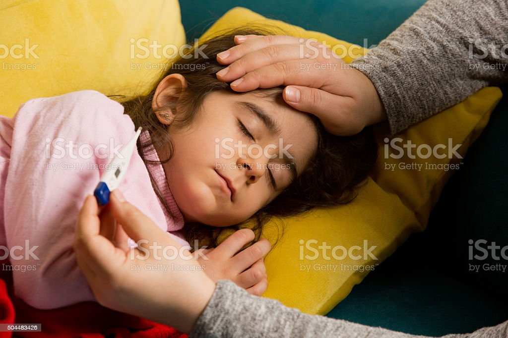 sick child and mother stock photo