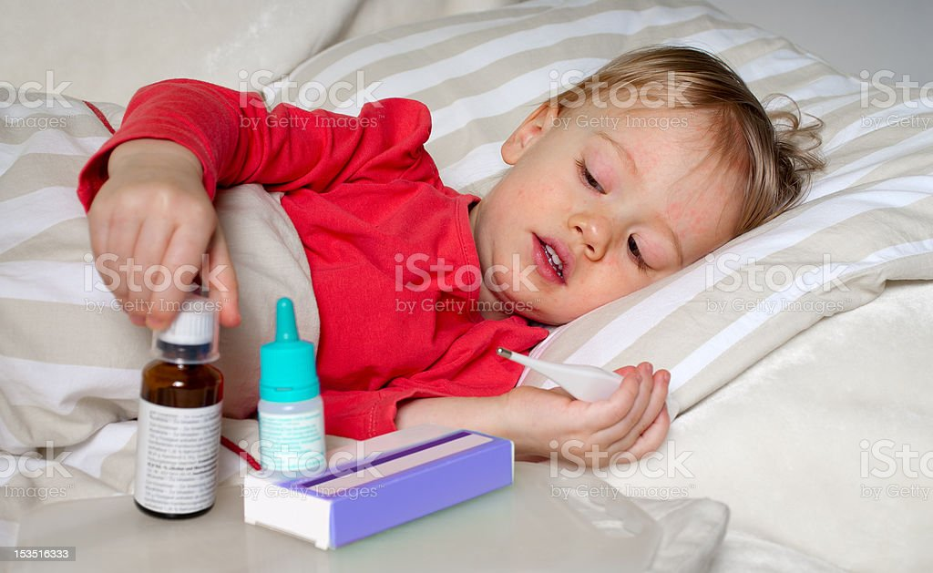 sick child in bed stock photo