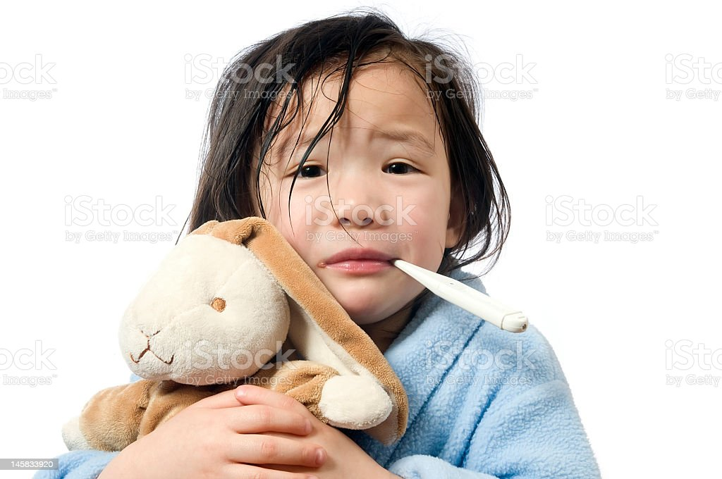 Sick child with fever and plush toy stock photo