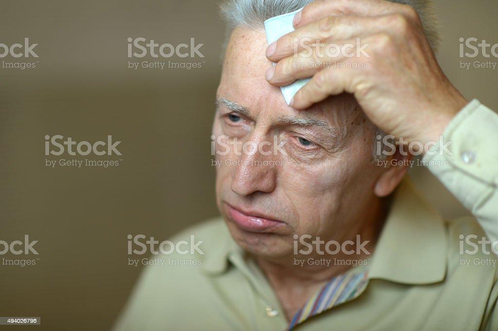 Sick elderly man stock photo
