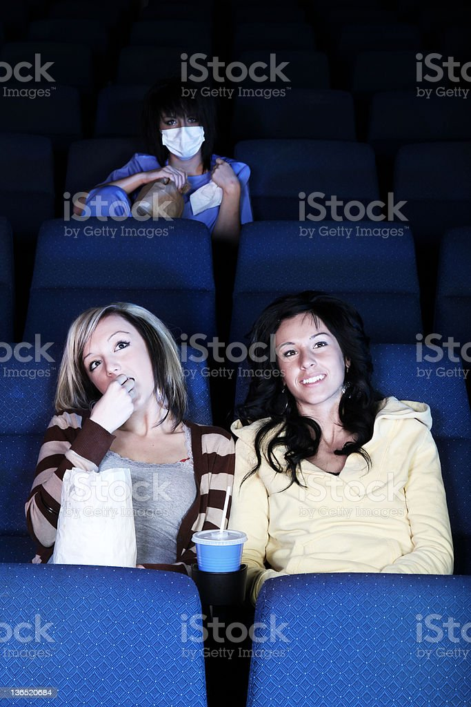 Sick girl at theatre with H1N1 stock photo
