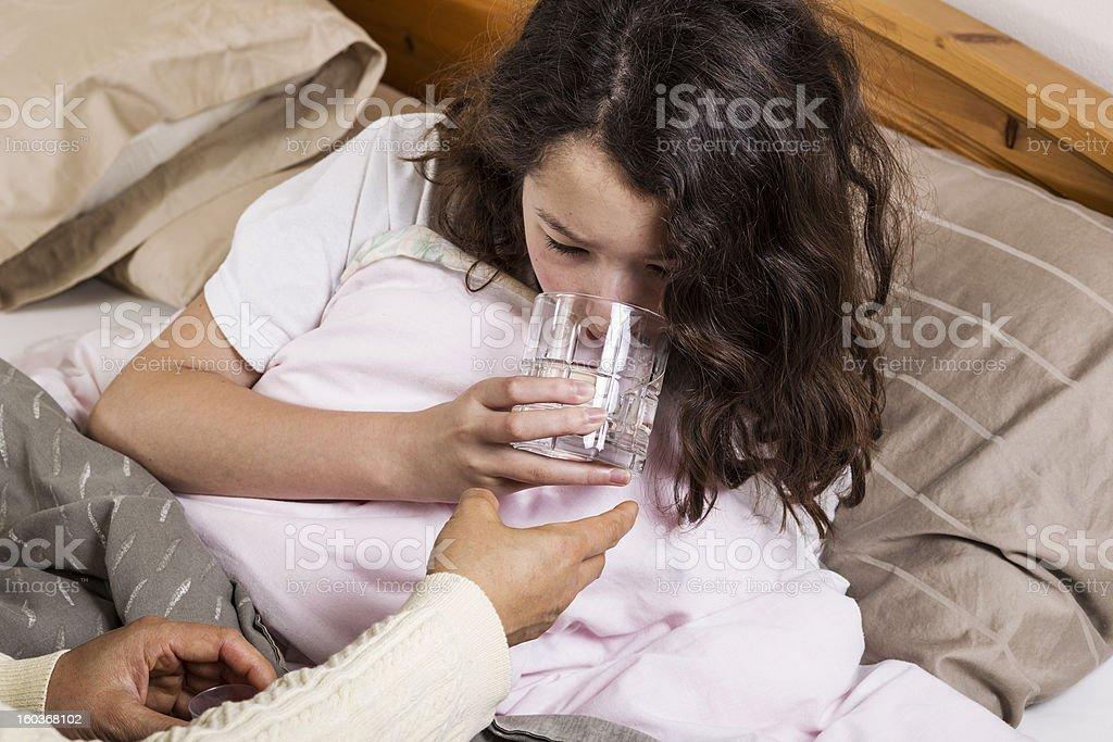 Sick Girl Drinking Water royalty-free stock photo