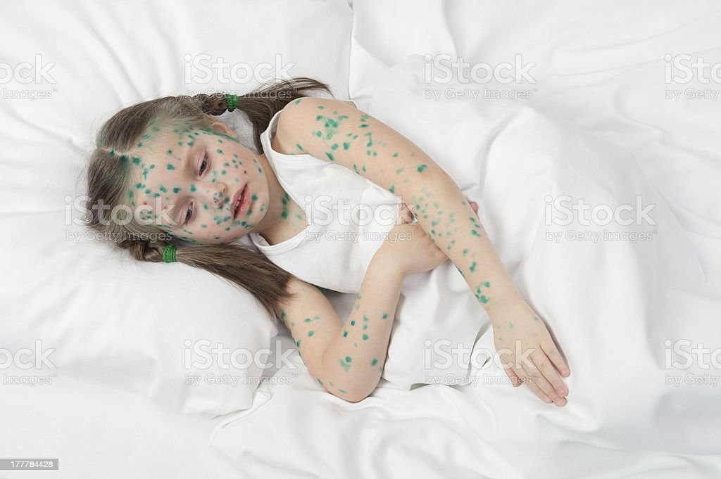 sick girl in white bed royalty-free stock photo