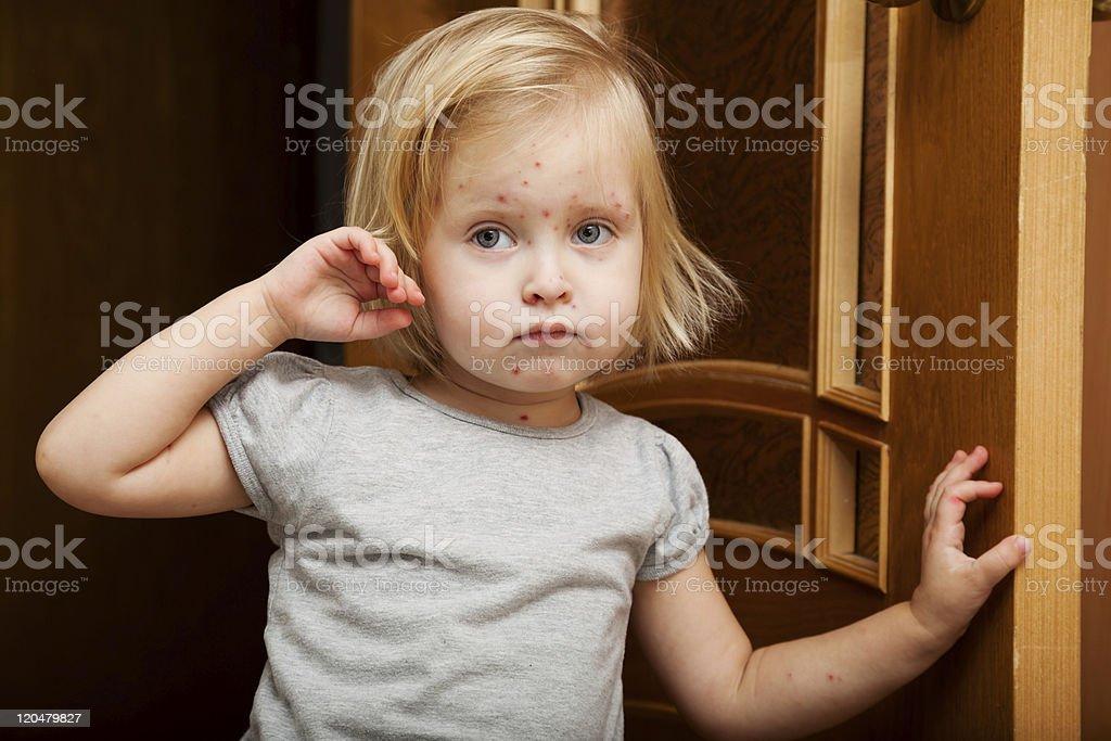 sick girl is near the door stock photo