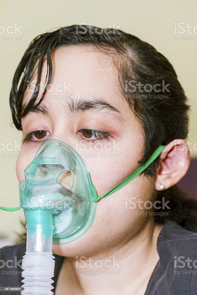 Sick girl receiving respiratory therapy stock photo