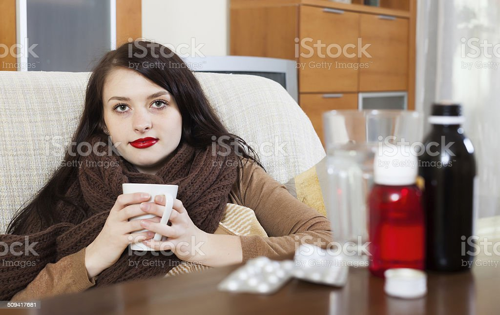 Sick girl with medications stock photo