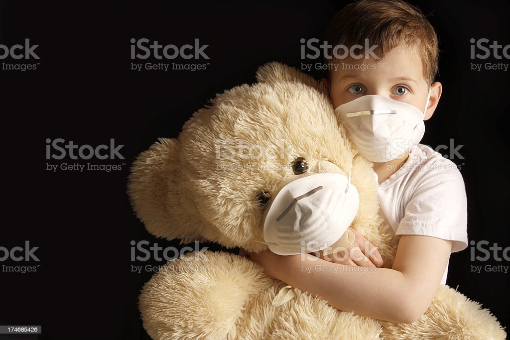 Sick Kid and Teddy bear. royalty-free stock photo