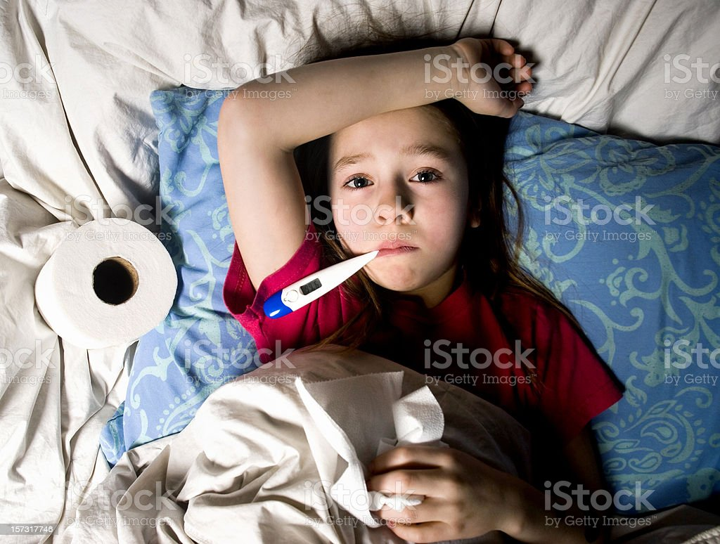 Sick Little Girl in Bed with Thermometer royalty-free stock photo