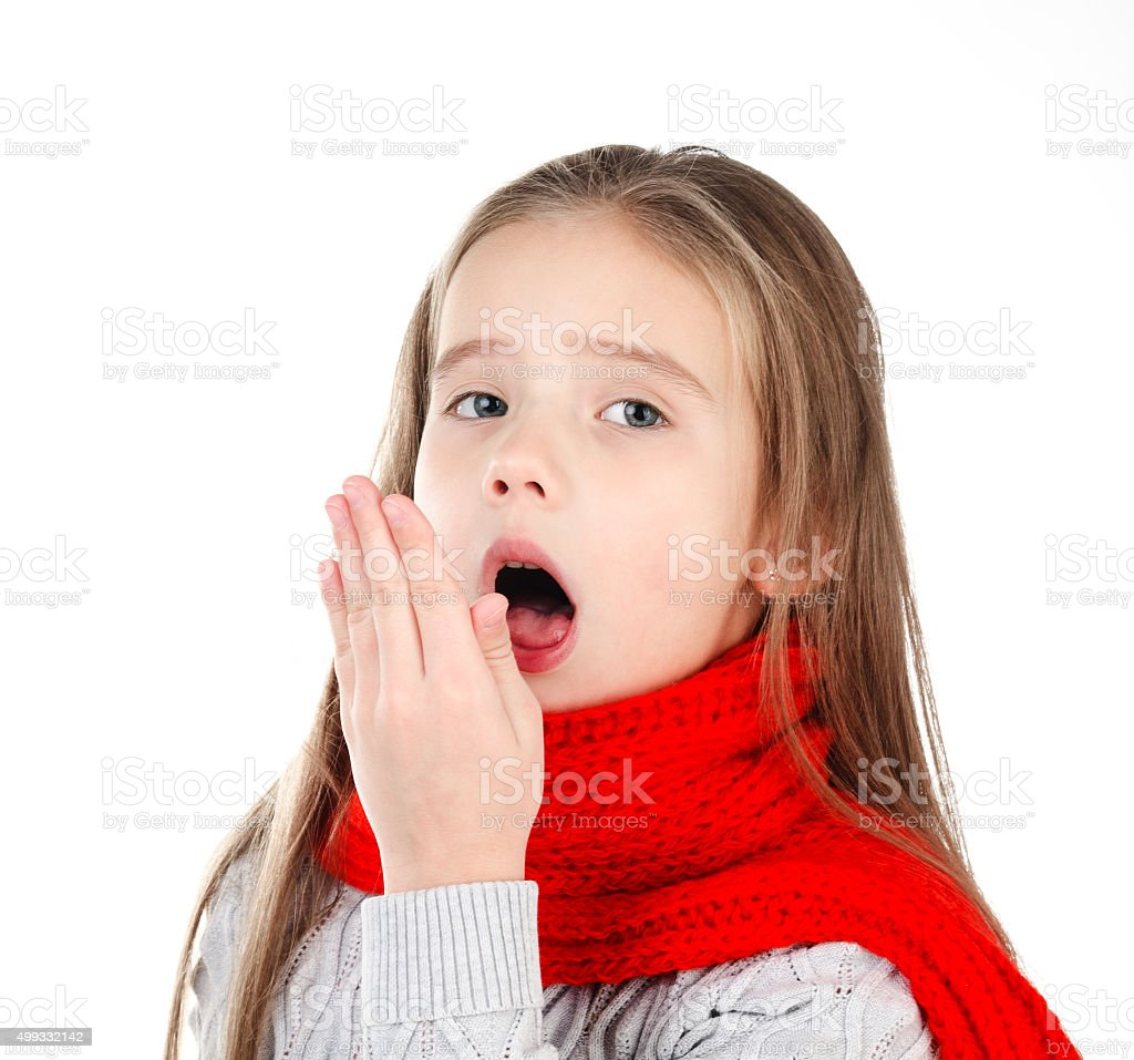Sick little girl in red scarf coughing stock photo