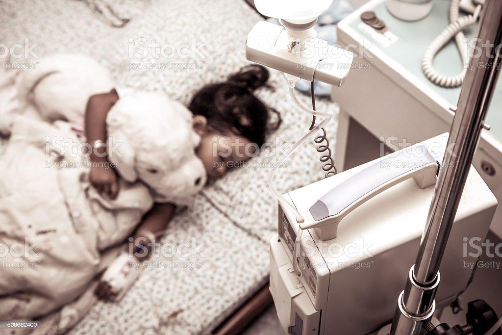 Sick little girl sleeping in the hospital stock photo