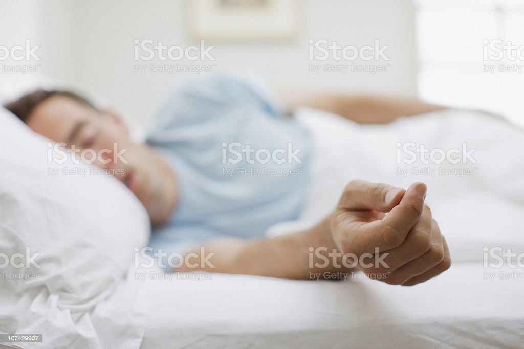 Sick man sleeping in bed royalty-free stock photo