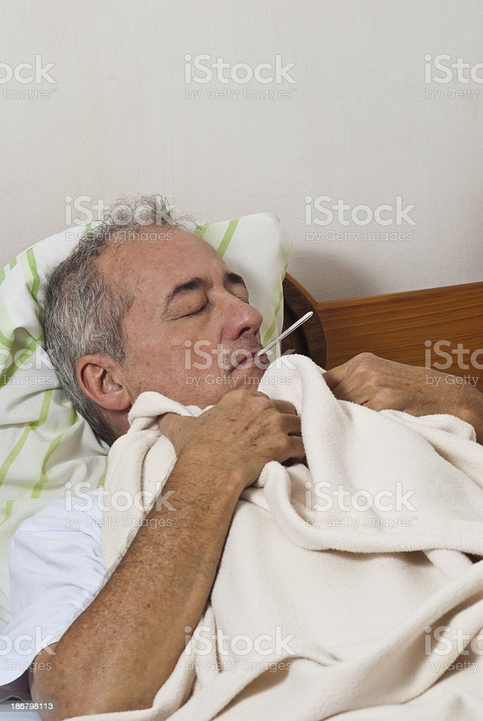 Sick man with flu in the bed royalty-free stock photo