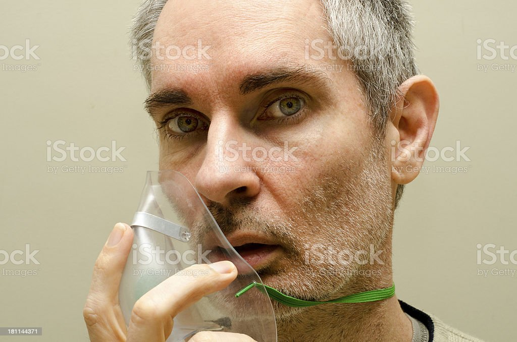 Sick man with oxygen mask stock photo
