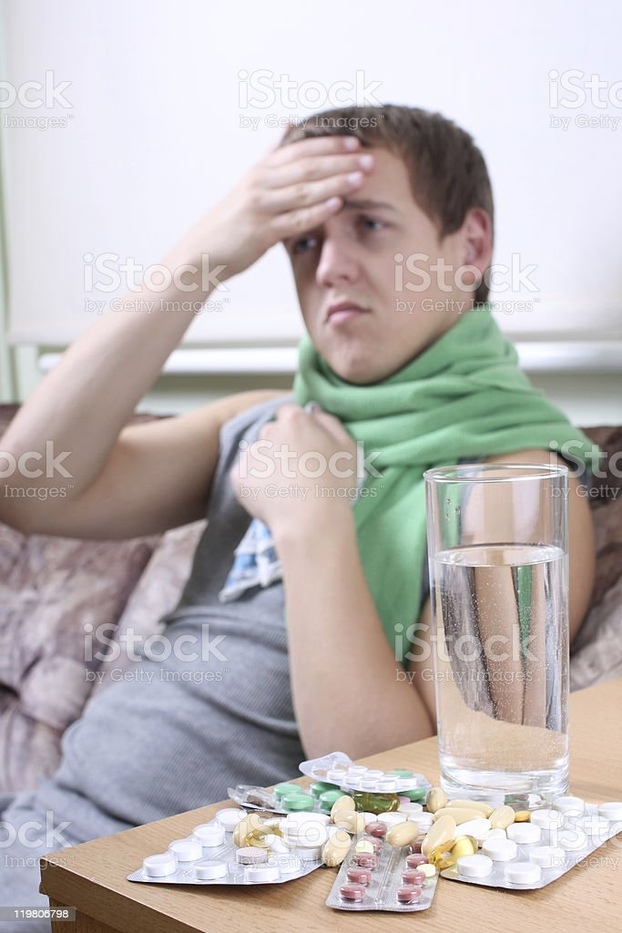 sick man with tablets ans glass of water royalty-free stock photo
