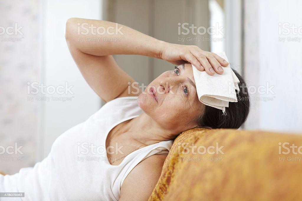 sick mature woman stock photo