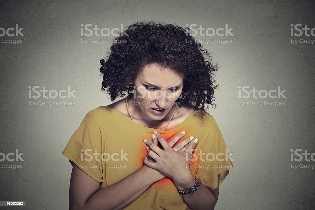 sick middle aged woman with heart attack, pain stock photo