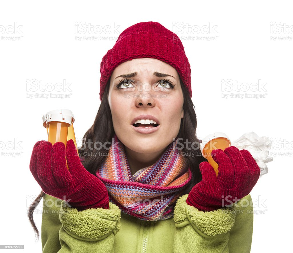 Sick Mixed Race Woman with Empty Medicine Bottles and Tissue stock photo