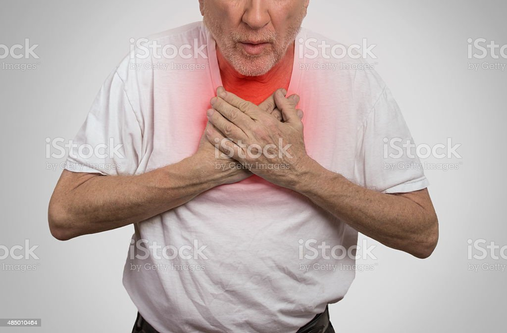 sick old man, elderly guy, having severe infection, chest pain stock photo