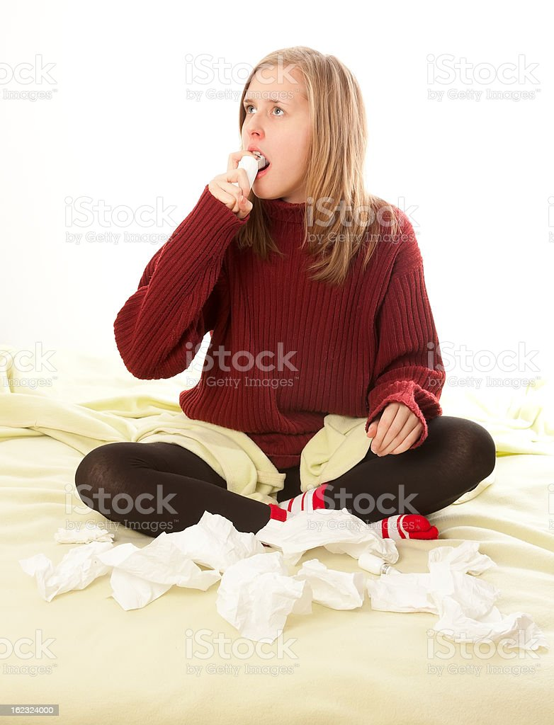 Sick person using respiratory spray royalty-free stock photo